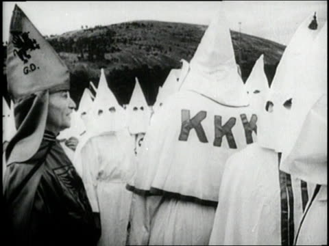 the ku klux klan stands around burning cross at night - ku klux klan stock videos and b-roll footage