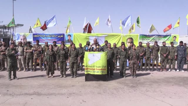 the kurdish led force that expelled the islamic state group from raqa hailed a historic victory friday in the devastated city's stadium and vowed to... - syrian democratic forces stock videos & royalty-free footage