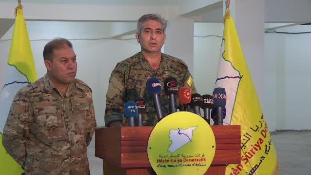 the kurdish led syrian democratic forces hold a press conference in hasakeh in which they decried being abandoned by washington and called their... - syrian democratic forces stock videos & royalty-free footage