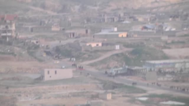 the kurdish peshmerga forces managed to defeat isil after three days of clashes and took control of iraq's sinjar town near mosul on 20 december 2014 - ninawa stock videos & royalty-free footage