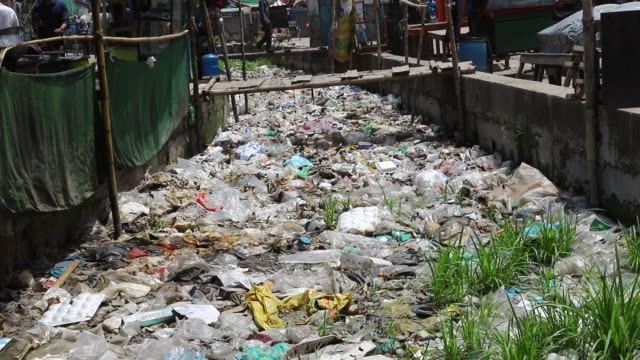 the kutubkhali canal in dhaka is filled with garbage mostly plastic bag and polyethylene millions of carelessly discarded plastic bags choke the... - polyethylene stock videos and b-roll footage
