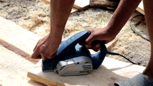 the laborer processes a wooden plank. - sander stock videos and b-roll footage