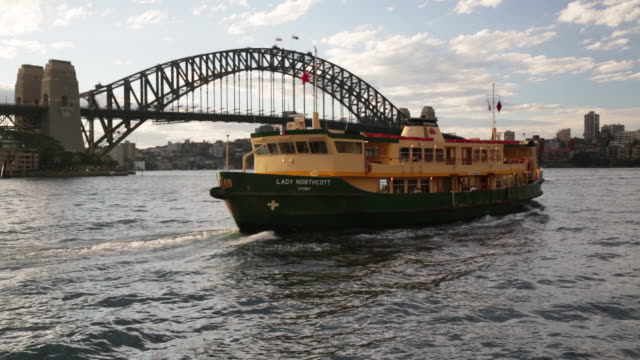 The Lady Northcott ferry passes in front of Sydney Harbour Bridge