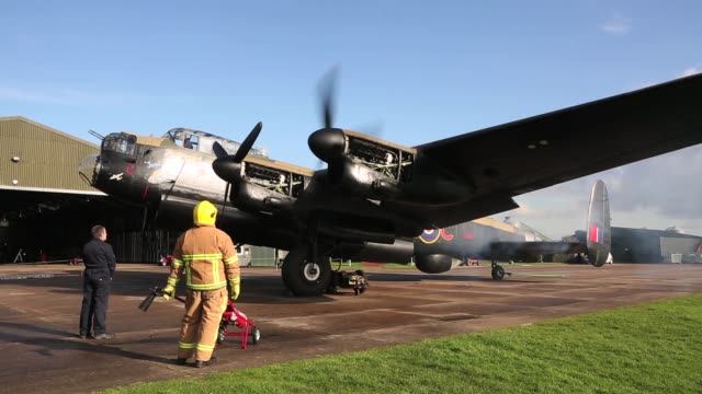 the lancaster bomber 'just jane' has its engines tested with the aim of getting it airworthy at lincolnshire aviation heritage centre on february 14... - bomber plane stock videos and b-roll footage