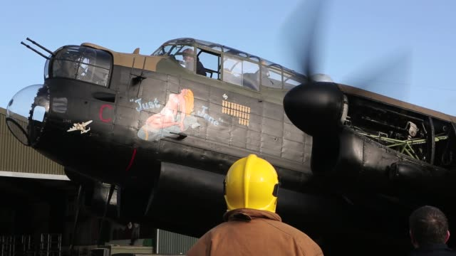 the lancaster bomber 'just jane' has its engines tested with the aim of getting it airworthy at lincolnshire aviation heritage centre on february 14... - lancaster bomber stock videos & royalty-free footage
