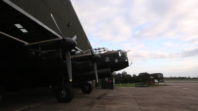 the lancaster bomber 'just jane' is returned to its hangar after an engine test with the aim of getting it airworthy at lincolnshire aviation... - lancaster bomber stock videos & royalty-free footage