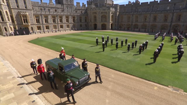 """the land rover hearse moves into postition at the state entrance of windsor castle, for prince philip, duke of edinburgh's funeral - """"bbc news"""" stock videos & royalty-free footage"""