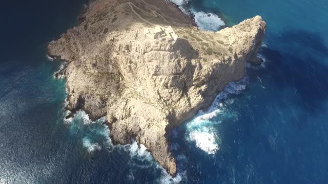 the landscape of castello di punta troia by the blue sea in sicily, italy - castello video stock e b–roll
