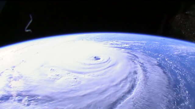 stockvideo's en b-roll-footage met the large size of the clouds and winds churning in the category 4 hurricane are seen in detail the powerful storm puts millions of people at risk and... - spiraal kronkeling