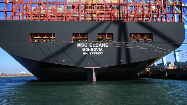 the largest container ship to ever call in the united states the mediterranean shipping company's eloane makes berth at the port of los angeles on... - moored stock videos & royalty-free footage