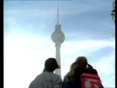 `the last days of the wall' pab of live broadcast gavin scott report from west to east west german family visit east berlin - east berlin stock videos and b-roll footage