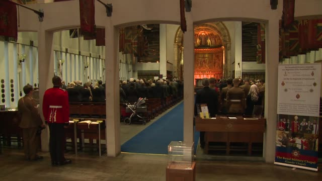 atmosphere the last post at remembrance sunday service at the guards' chapel on november 13 2016 in london england - remembrance sunday stock videos and b-roll footage