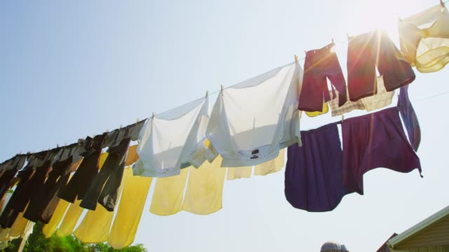 the laundry hanging on the line - textile stock videos & royalty-free footage