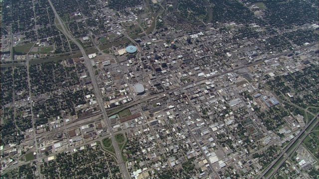 the layout of a city, surrounded by neighborhoods, displays urban sprawl in wichita, kansas. - kansas stock videos & royalty-free footage