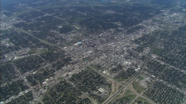the layout of a city, surrounded by neighborhoods, displays urban sprawl in wichita, kansas. - wichita stock videos & royalty-free footage