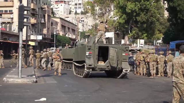 the lebanese army on wednesday reportedly launched patrols in the city of tripoli where people protesting the high cost of living and the... - democracy stock videos & royalty-free footage