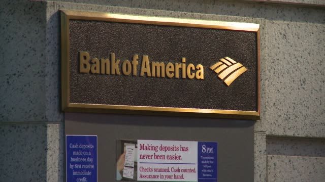 the legal legacy of the housing bust weighed on bank of america earnings wednesday resulting in a quarterly loss even as some operating units posted... - bank of america stock videos & royalty-free footage
