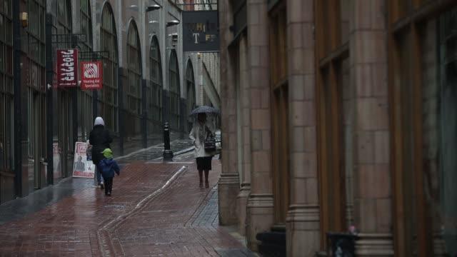 the legs of pedestrians walk through a shopping street in birmingham, u.k. on tuesday, aug. 13 pull focus shoppers walking down street, tilt down... - narrow stock videos & royalty-free footage