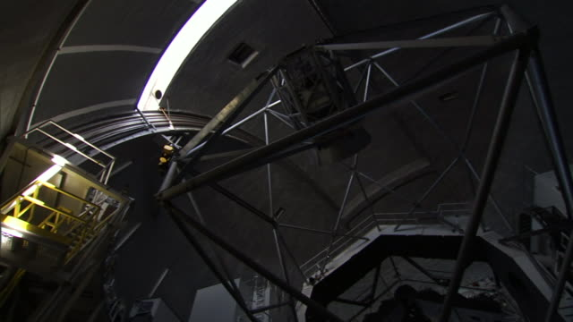 the lens of a telescope moves below a dome shutter at the w. m. keck observatory on hawaii's big island. - observatory stock videos & royalty-free footage