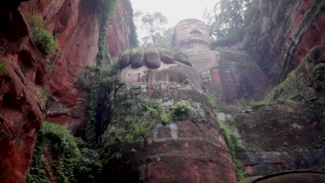 the leshan giant buddha built during the tang dynasty is the largest stone buddha in the world and has been listed as a unesco world heritage site... - sculpture stock videos & royalty-free footage