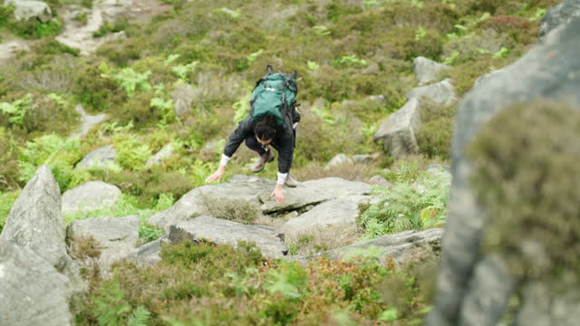 the less you carry, the higher you go - boulder rock stock videos & royalty-free footage