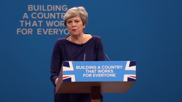 the letter 'f' falls from the conservative party sign as theresa may gives her speech to the conference in manchester - theresa may stock videos & royalty-free footage