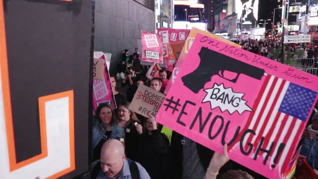 the lgbtq group gays against guns nyc rallied in union square and marched to times square in response to the las vegas massacre. hundreds marched... - gun control stock videos & royalty-free footage
