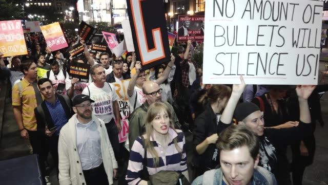 the lgbtq group gays against guns nyc rallied in union square and marched to times square in response to the las vegas massacre hundreds marched... - protesta contro la violenza armata video stock e b–roll