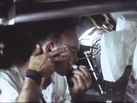 stockvideo's en b-roll-footage met the lifestyle of astronauts inside the spaceship michael collins shaves his face apollo 11 was the first space flight landing humans in the moon neil... - missiehuis