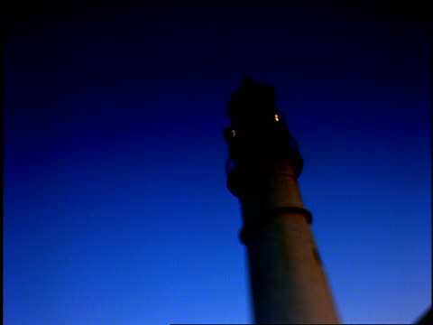 the light at the top of a lighthouse revolves at golden hour. - golden hour stock videos & royalty-free footage