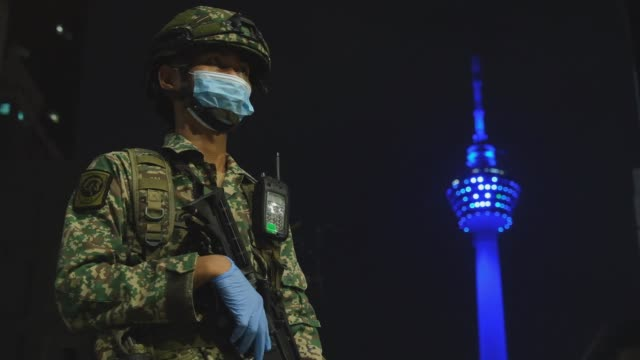 the 'light it blue' campaign begins on the night of april 30 in conjunction with may 1 labour day to honor the services of the malaysia frontline... - menara kuala lumpur tower stock videos & royalty-free footage