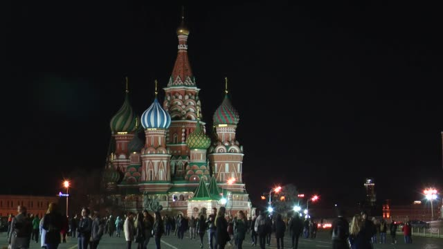 the lights are turned off at red square where people gathered to mark the earth hour 2017 environmental campaign in moscow russia on march 25 2017... - earth hour stock videos & royalty-free footage