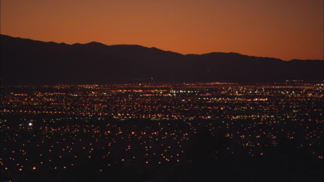 the lights of las vegas twinkle under an orange sky. - wide shot stock videos & royalty-free footage