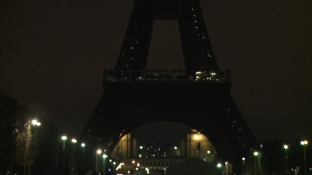 the lights of the eiffel tower were turned off on saturday to mark earth hour but due to security concerns the monument was only left in darkness for... - earth hour stock videos & royalty-free footage