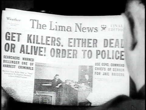 the lima news headline reading get killers either dead or alive order to police / lima ohio united states - bankräuber stock-videos und b-roll-filmmaterial