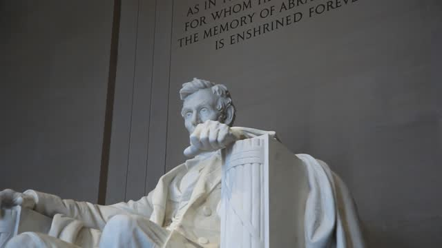 the lincoln memorial is a us national memorial built to honor the 16th president of the united states, abraham lincoln. it is on the western end of the national mall in washington, d.c., across from the washington monument, and is in the form of a neoclas - monument stock videos & royalty-free footage