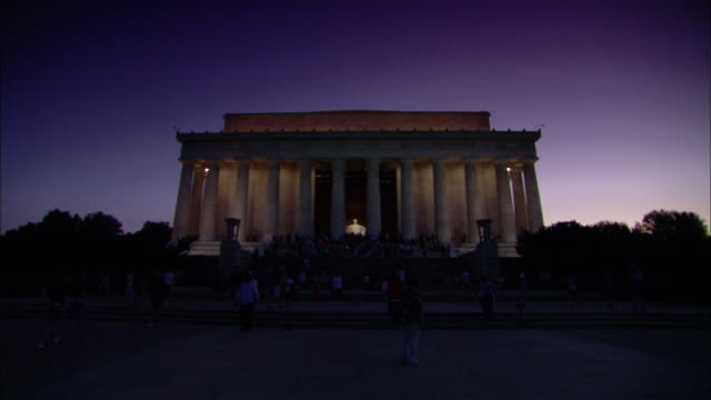 The Lincoln Memorial is lighted at twilight.