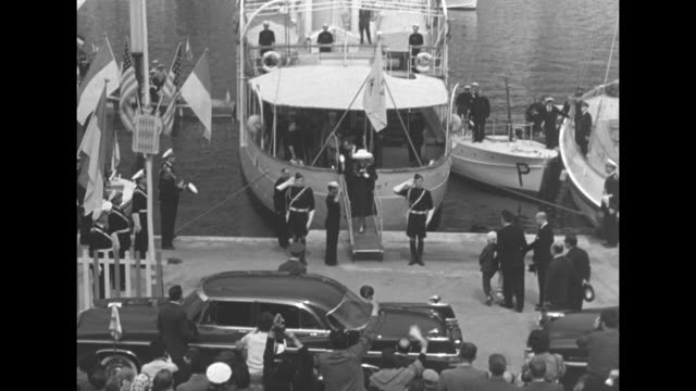ws the liner ss constitution / tracking left cheering residents of monaco / tilt down grace kelly and prince rainier iii disembark from the yacht deo... - royal palace monaco stock videos and b-roll footage