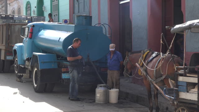 the liquid is transported into the building using buckets the dining room offers meals to seniors in need there is a horsedrawn cart in the scene... - social security stock videos and b-roll footage