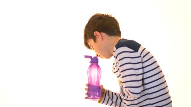 The little boy is drinking water