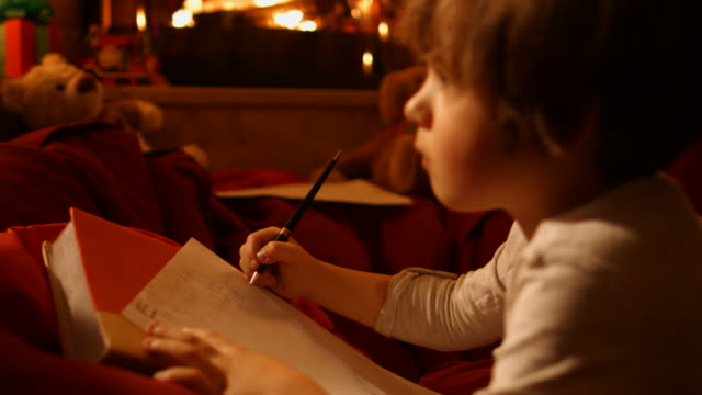 the little boy writes a letter to santa - writer stock videos & royalty-free footage