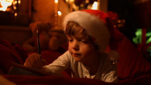 the little boy writes a letter to santa - note message stock videos & royalty-free footage