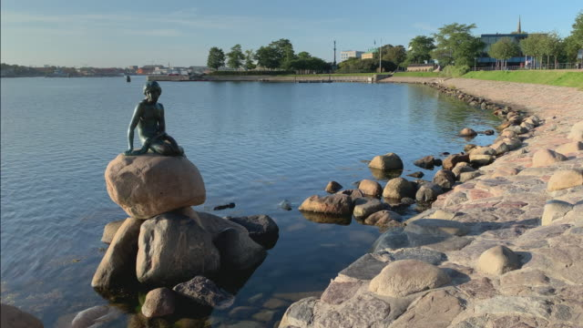 the little mermaid in copenhagen before the crowds arrive - literature stock videos & royalty-free footage