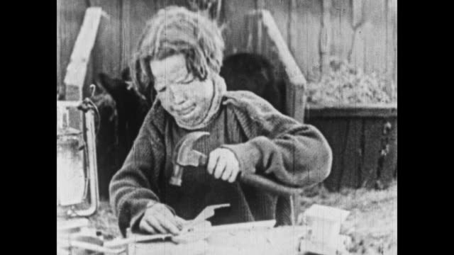 1926 the little rascal boys play with toys in a toy workshop - 1926 stock videos & royalty-free footage