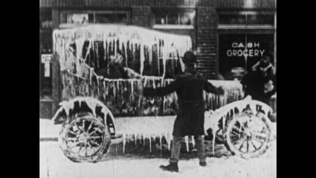 1926 the little rascals spray a car with water, causing icicles to form - ice stock videos & royalty-free footage