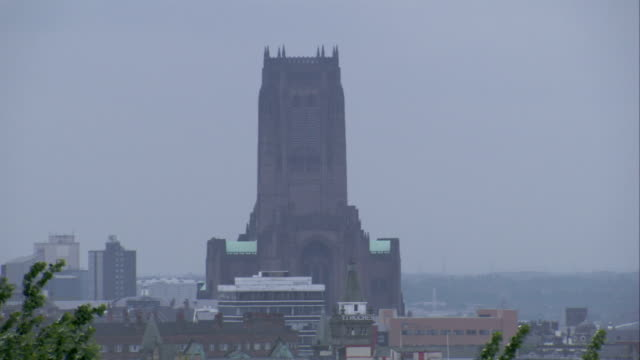 The Liverpool Cathedral towers high into a hazy sky. Available in HD.