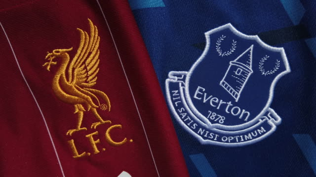 vidéos et rushes de the liverpool fc and everton fc club crests on their home shirts on may 18, 2020 in manchester, england. - everton