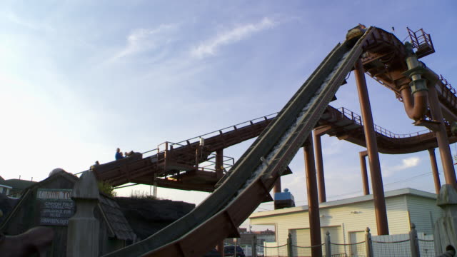 the log flume at an amusement park in new jersey. - water slide stock videos & royalty-free footage