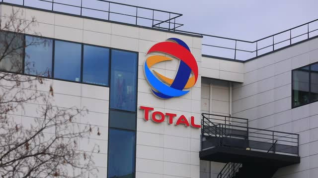 the logo of french oil and gas giant total sits on an office building on january 8, 2021 in reuil malmaison, france. the multinational total... - illustration stock videos & royalty-free footage