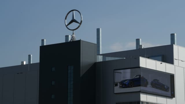 the logo of mercedes-benz on a factory roof factory, where car production has been halted, seen during the coronavirus crisis on april 8, 2020 in... - ベンツ点の映像素材/bロール
